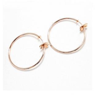 Золотые серьги кольца с клевером фото