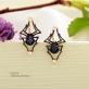 Серьги пауки золотые синий фианит