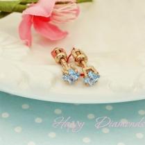 Золотые гвоздики с голубыми фианитами
